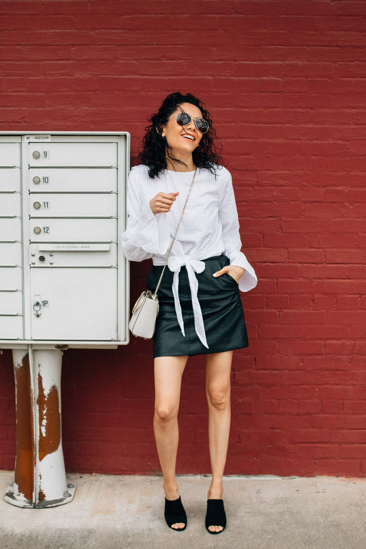 Houston based fashion blogger| Front tie top and black leather mini skirt