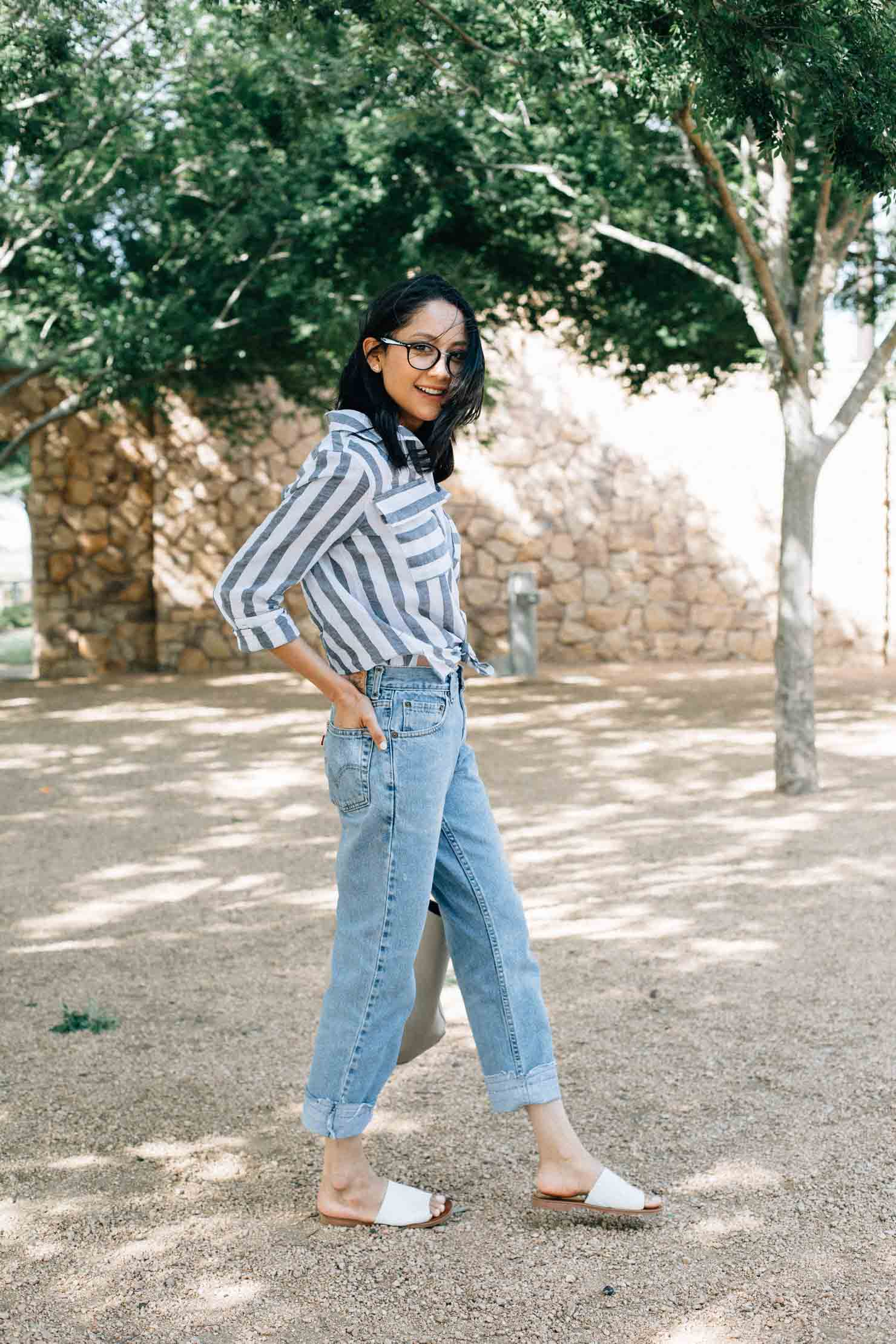 Lilly Beltran Houston based fashion & lifestyle blogger in Vintage Levi's denim and striped linen shirt