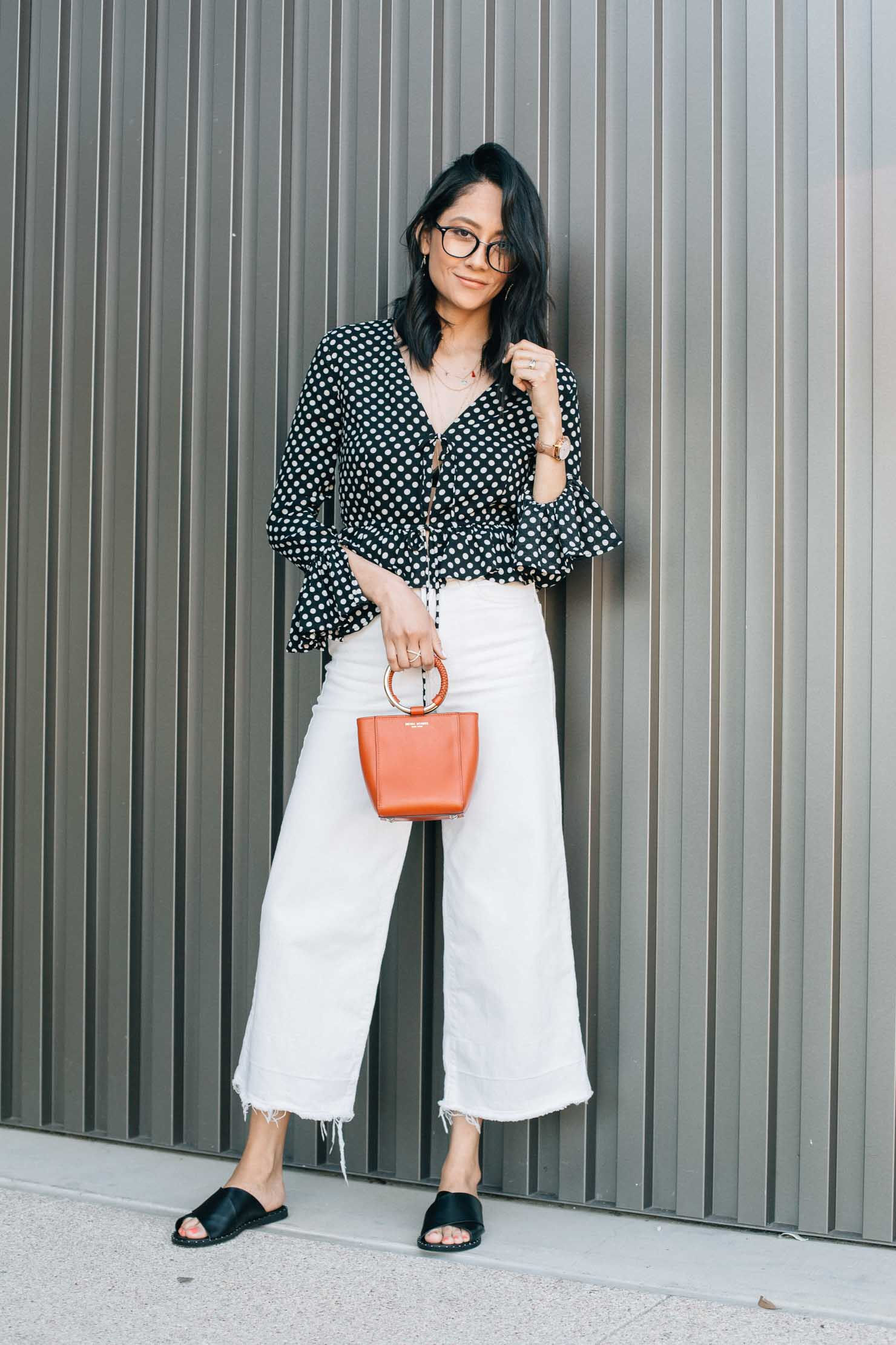 Fashion blogger Lilly Beltran | Polka dot crop top & wide leg denim | Henri Bendel Bag | Street Style