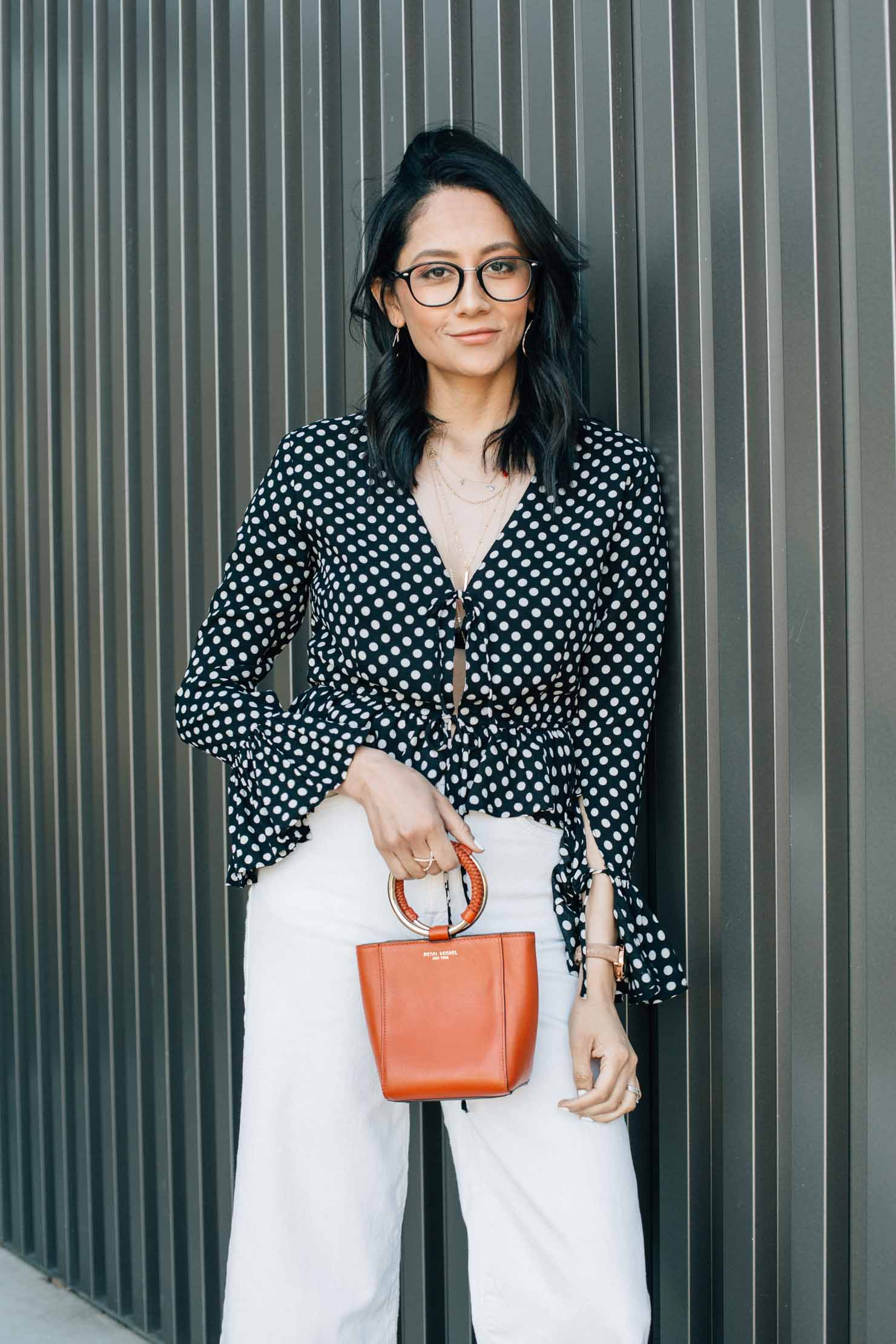 Lilly Beltran fashion blogger | Polka dot bell sleeve top | Wide leg denim | street style blogger
