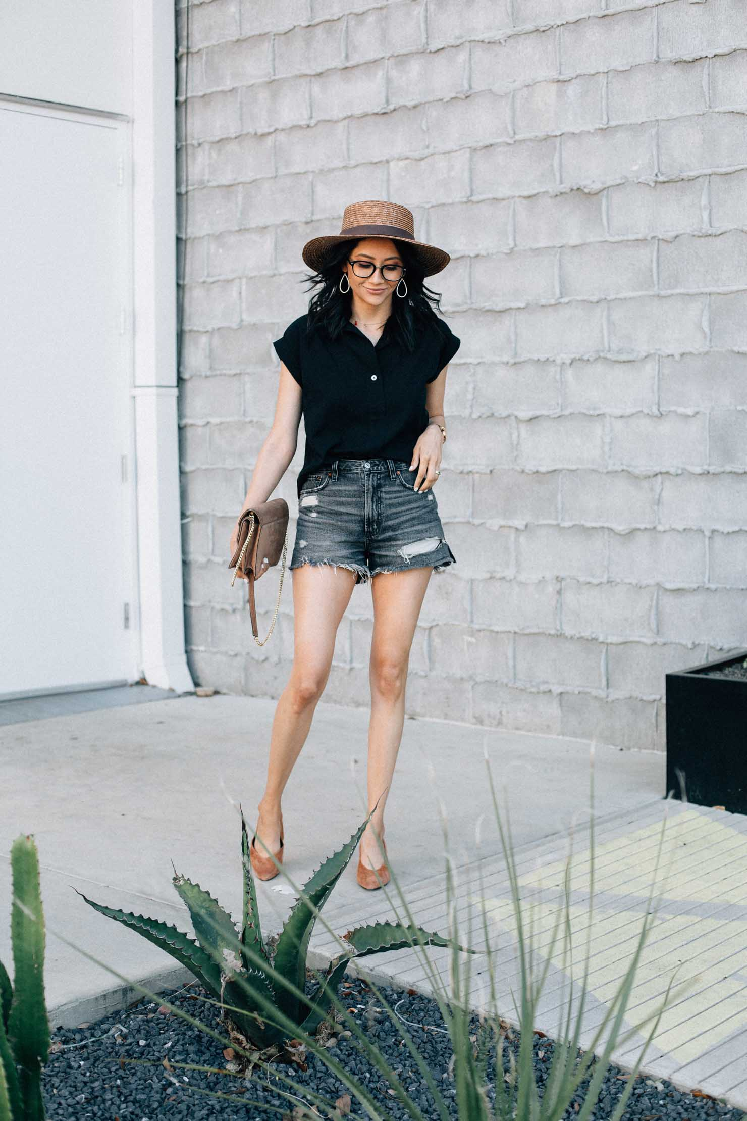 Lilly Beltran of Daily Craving fashion blog wears Abercrombie high waisted denim shorts with a black shirt and brown pumps for an effortless summer look