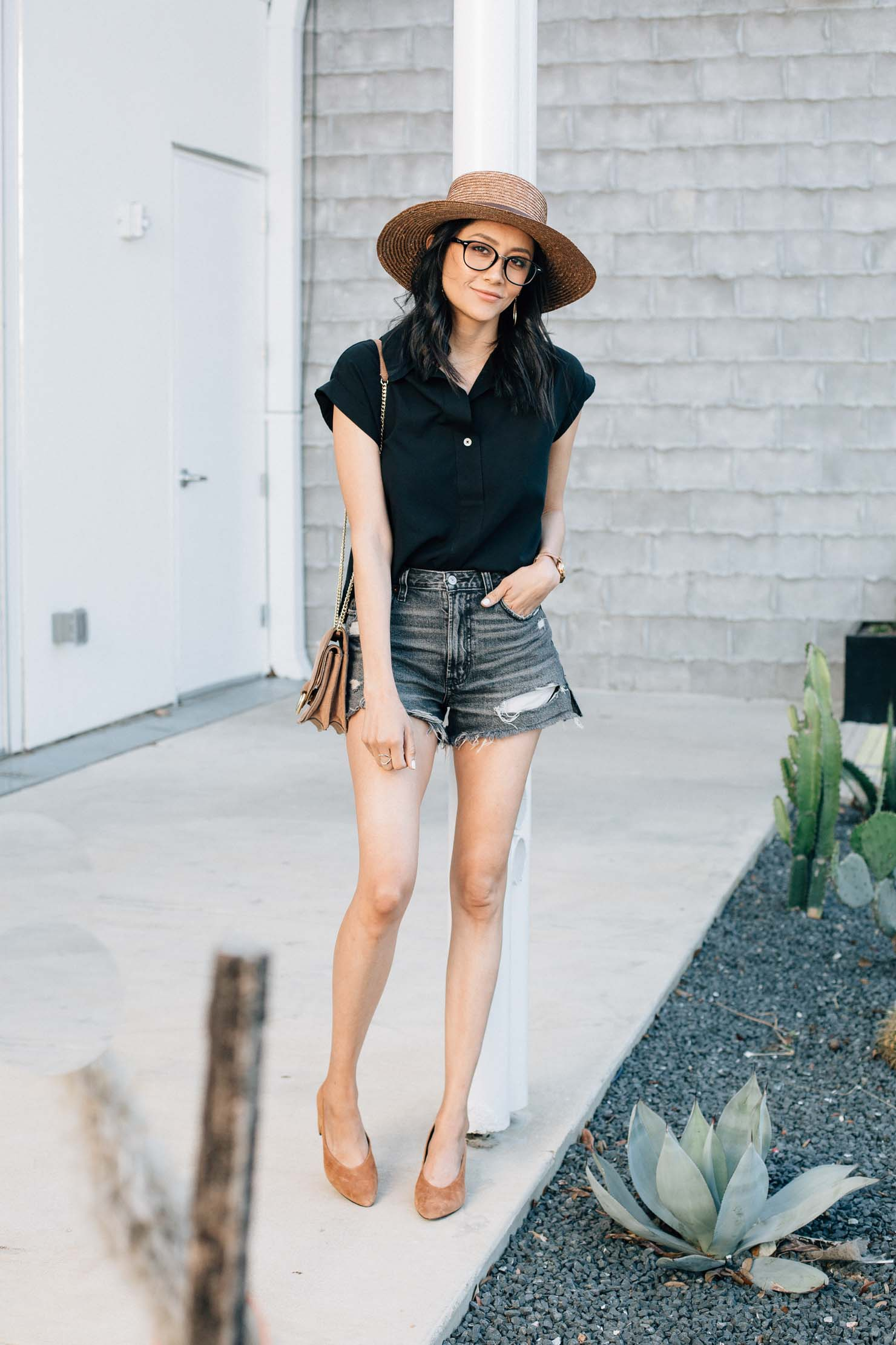 Fashion blogger Lilly Beltran styles Abercrombie high waisted Denim shorts with a black top and brown suede pumps for an effortless summer look