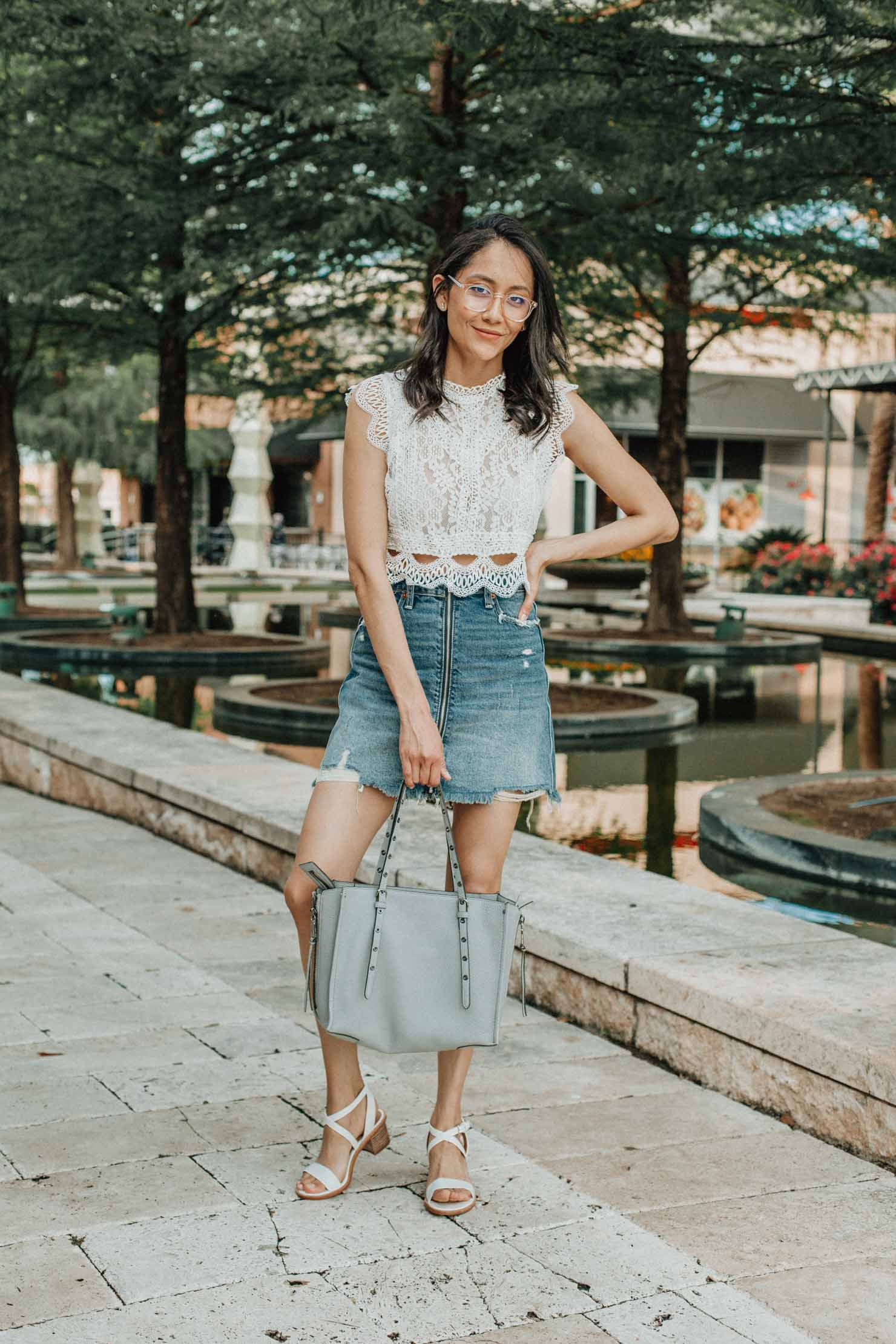 Lilly Beltran, Houston fashion blogger accessorizing her summer looks with Coastal glasses