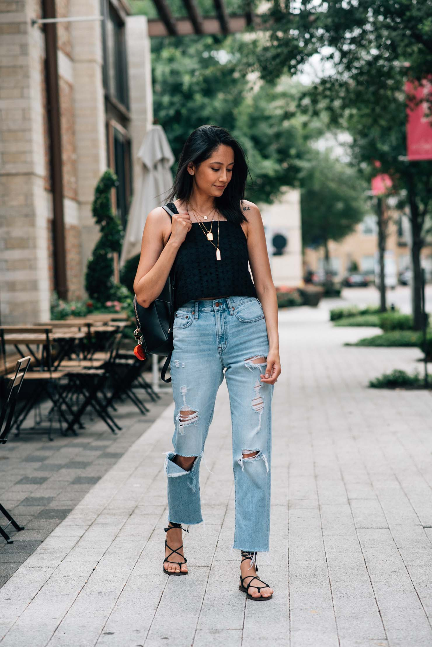 Eyelet crop top | Ripped jeans | Layered necklace | Lilly Beltran, fashion blogger | Street Style