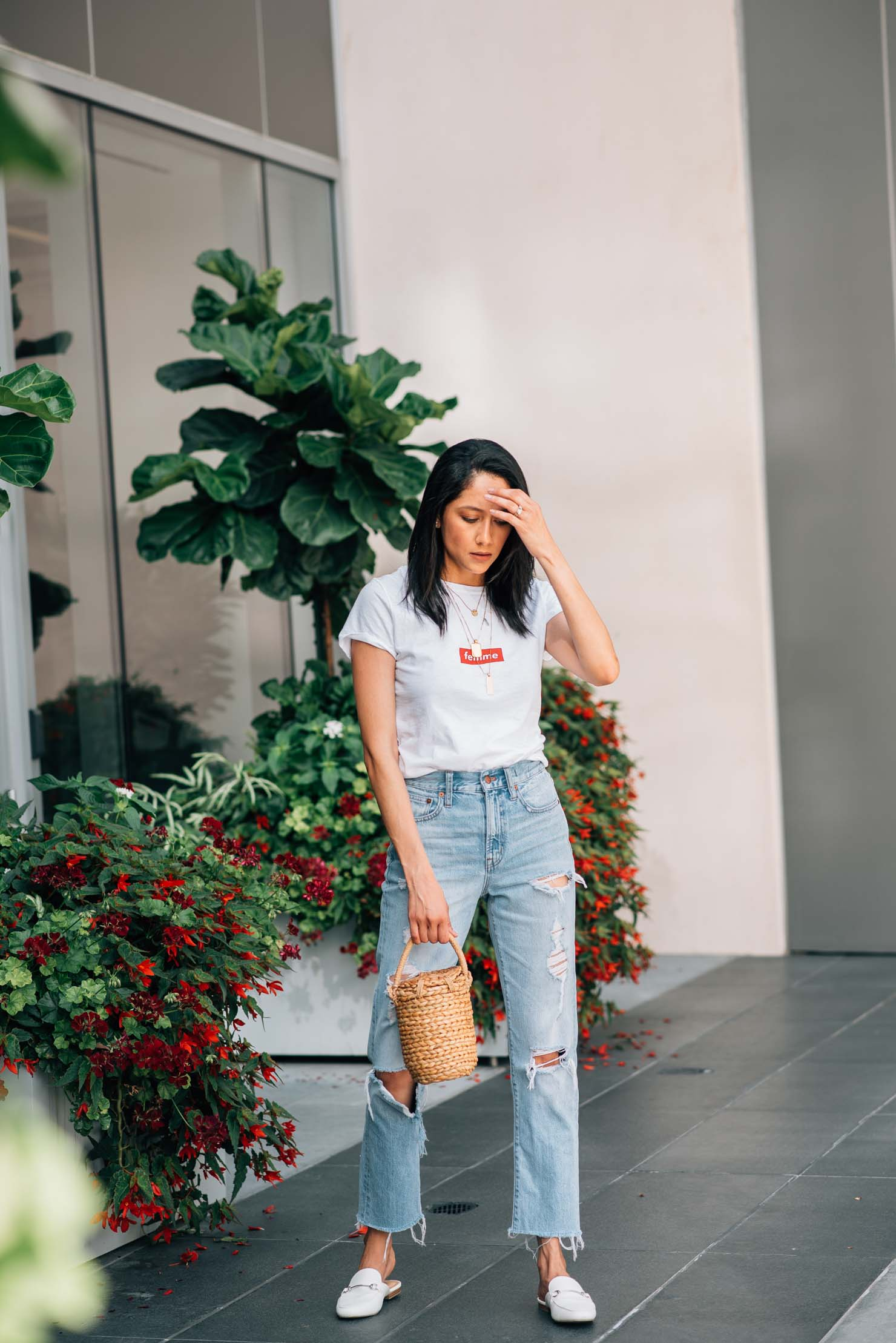 high waisted ripped jeans and white tee | Raffia bag and white slides | Street Style | Lilly Beltran, fashion blogger