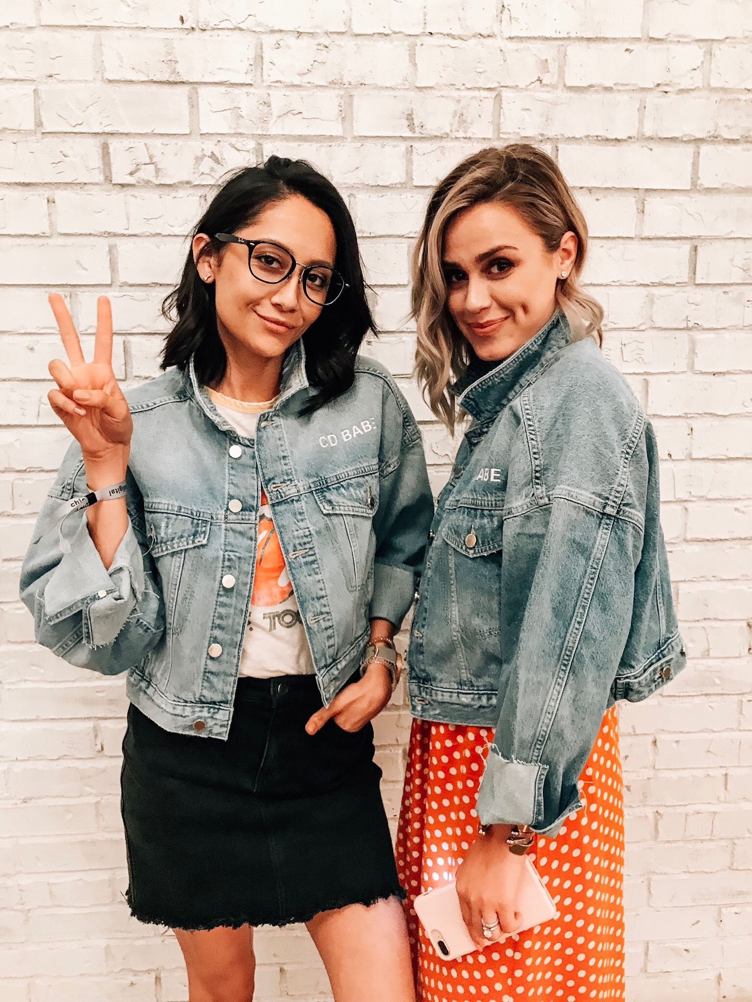 Bloggers Lilly Beltran & Elly Brown at the Chloe Digital World Tour in Dallas, TX wearing crop denim jackets.