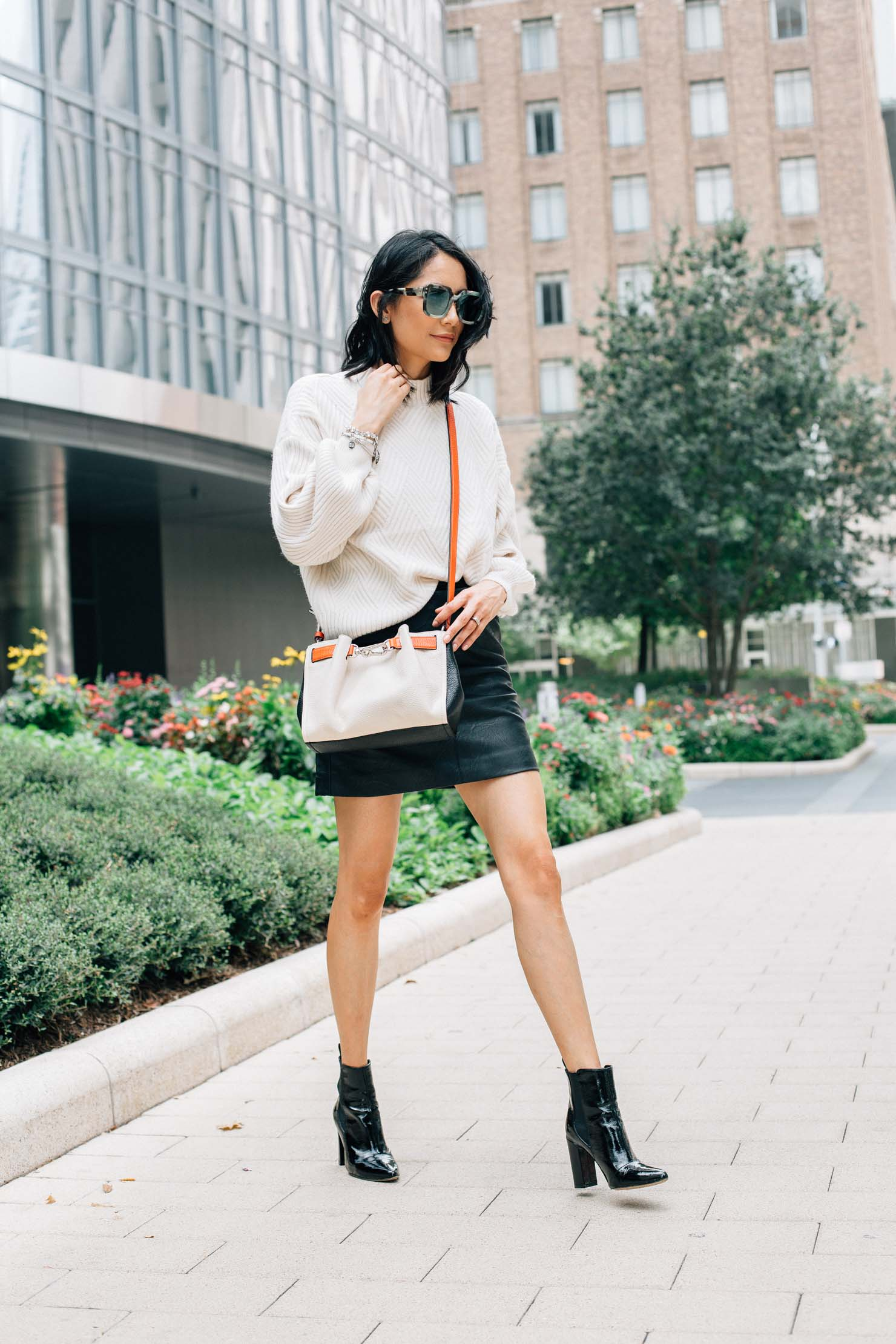 Lilly Beltran wearing a leather mini skirt with black patent leather booties
