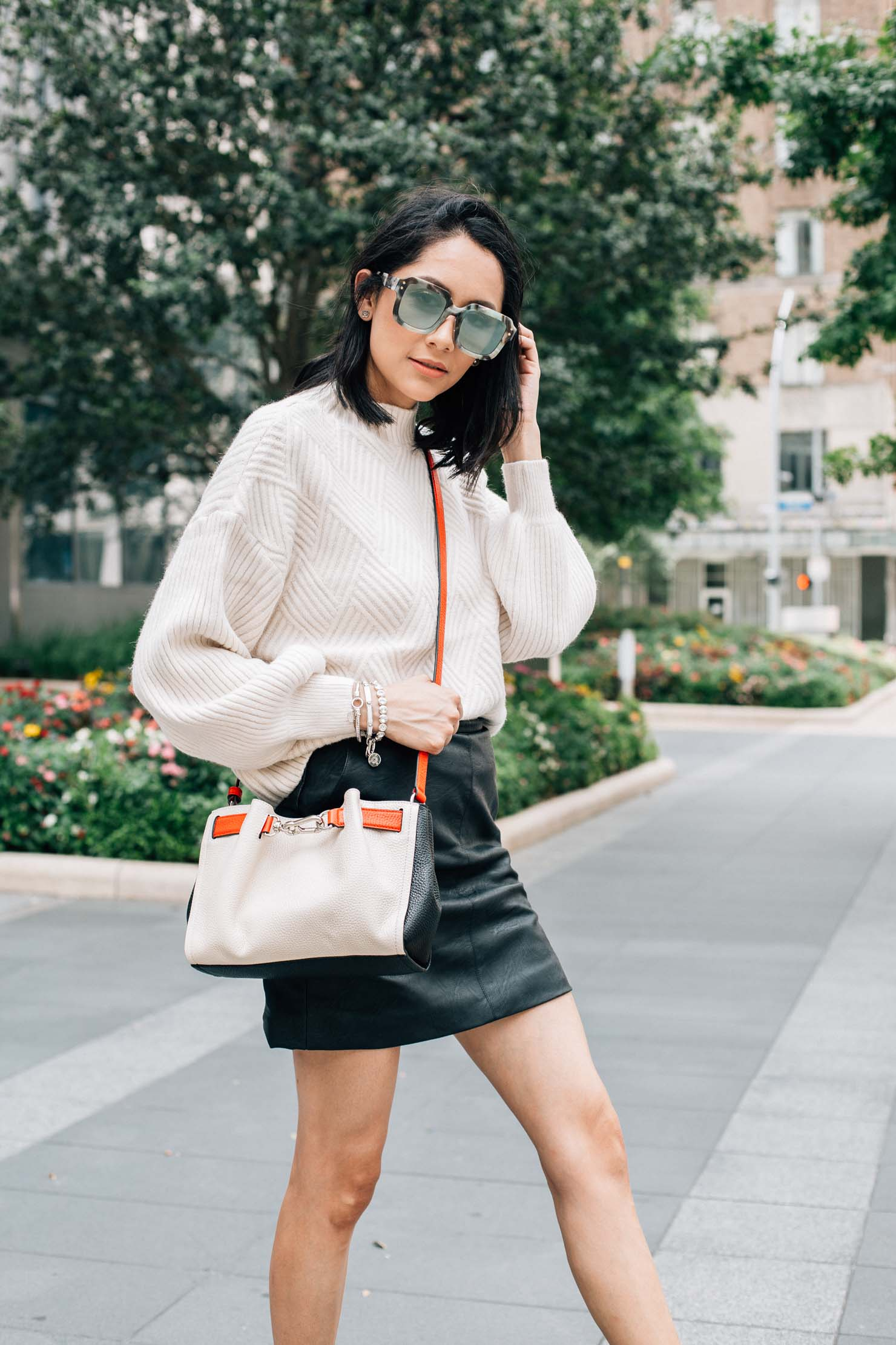 Fashion bloggers Lilly Beltran wearing a leather skirt and balloon sleeve sweater from chicwish