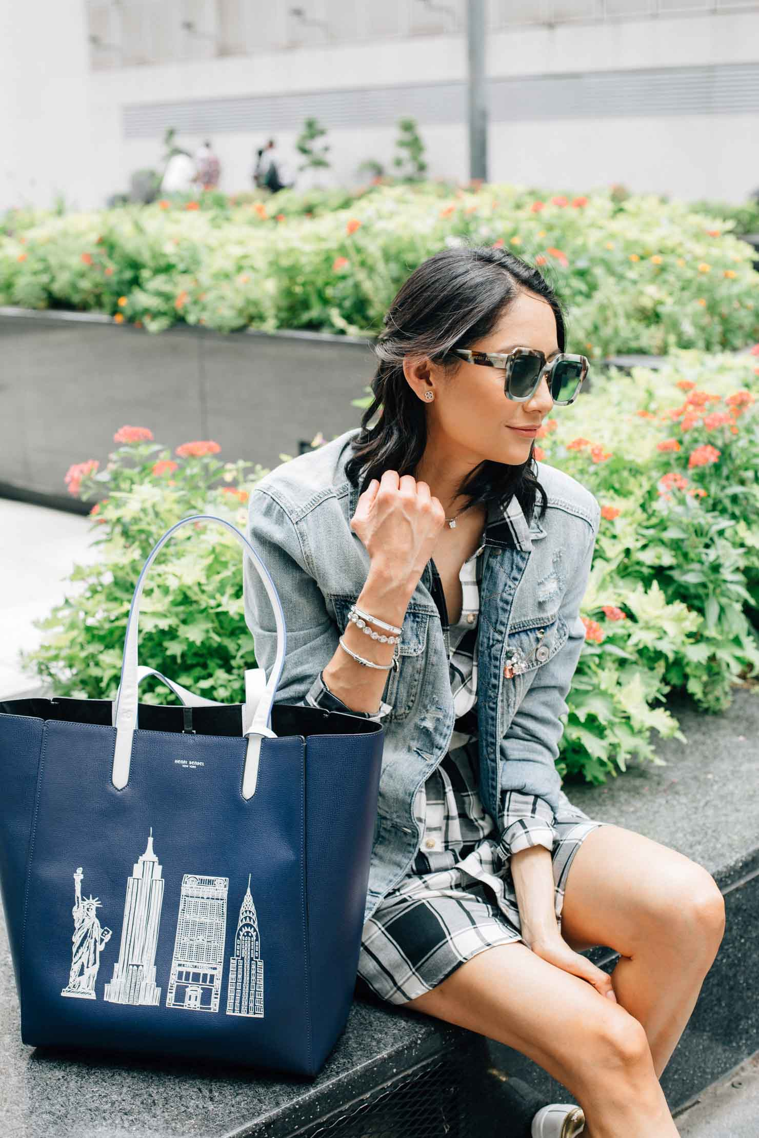 Gingham dress and jean jacket paired with a Henri Bendel bag