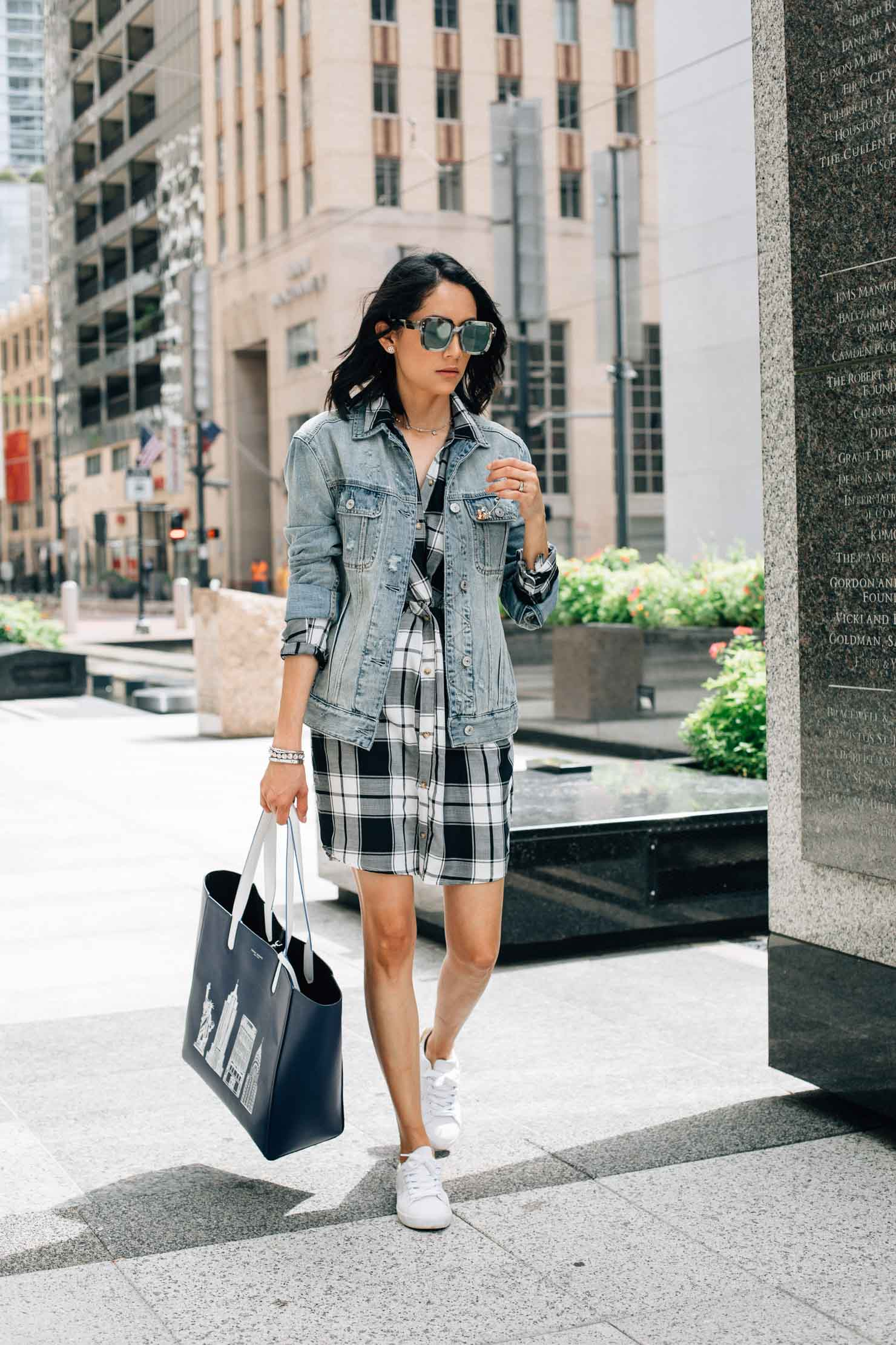 Lilly Beltran styles a gingham dress with an oversized denim jacket for a laid back fall look