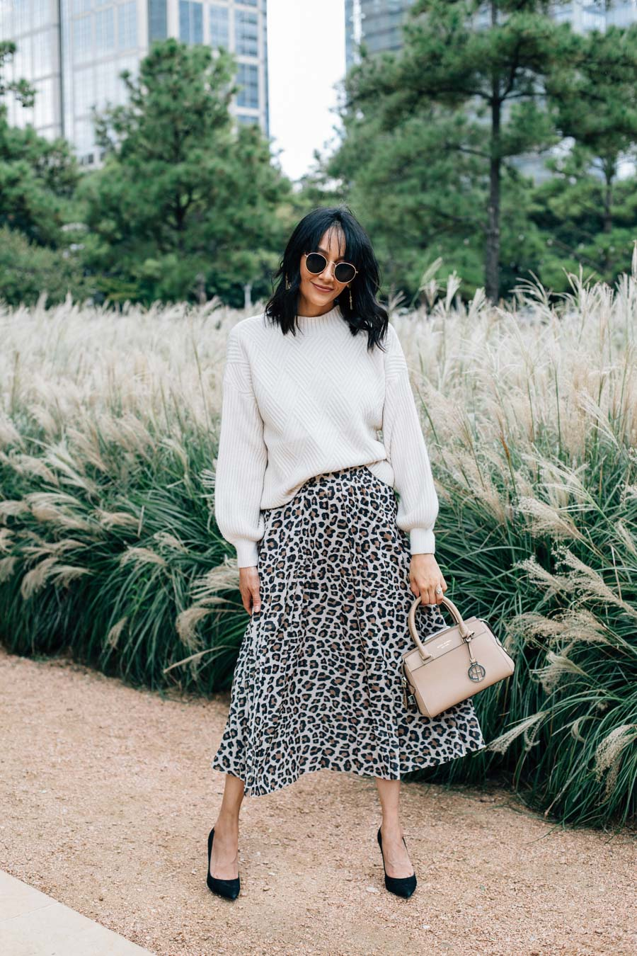 Lilly Beltran of Daily Craving blog wearing a leopard print midi skirt