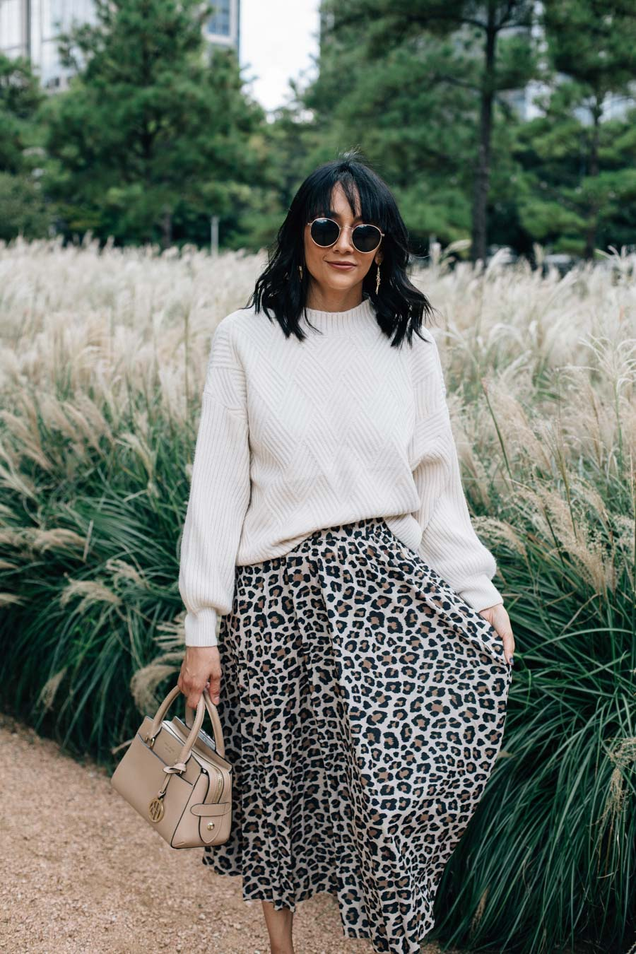 Lilly Beltran wearing a leopard print skirt with an oversized sweater and black pumps.
