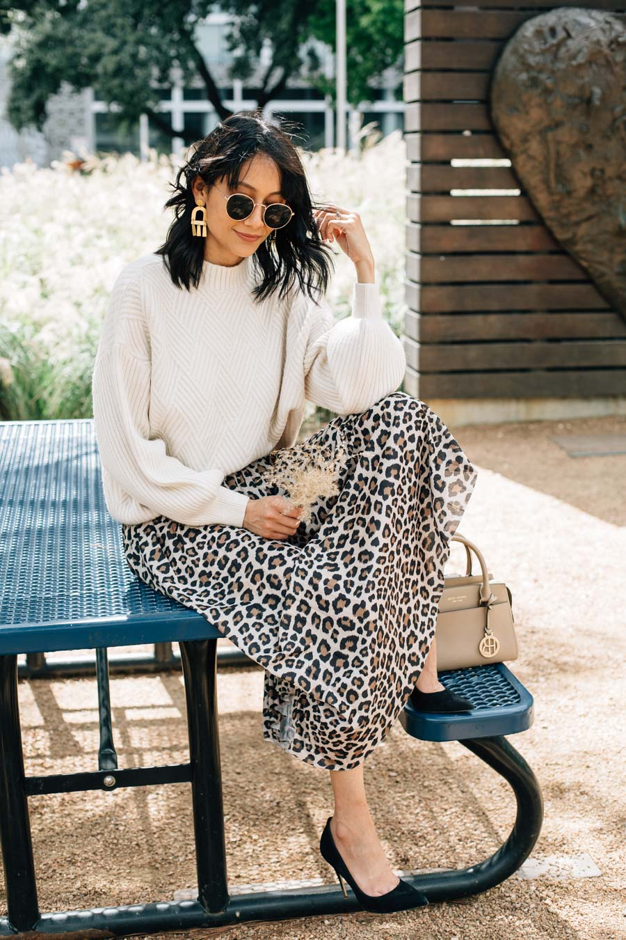Lilly Beltran wearing an animal print skirt and oversized sweater.