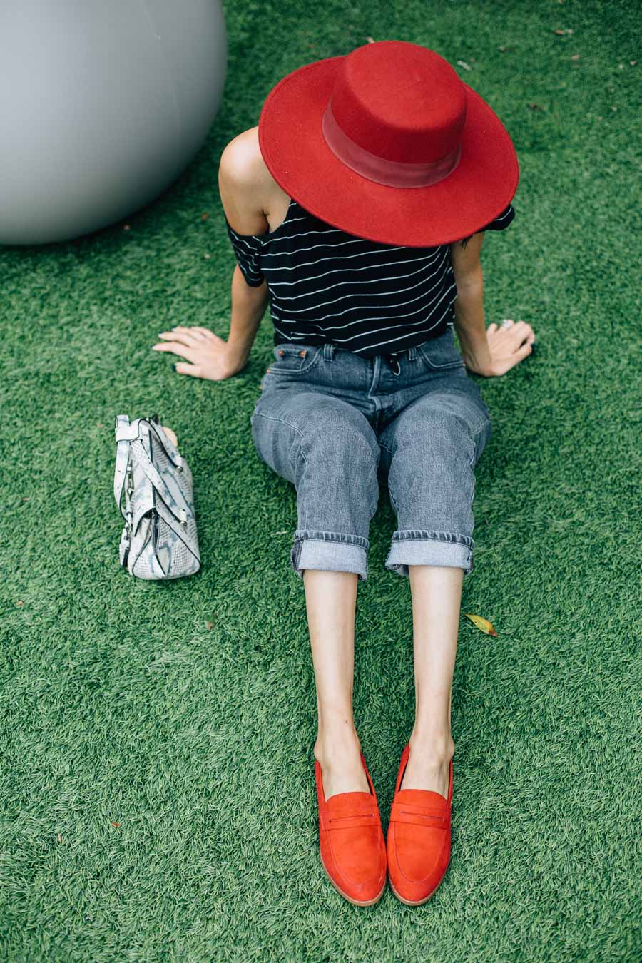 Lilly Beltran of Daily Craving blog wearing a pair of suede red loafers from Restricted Shoes