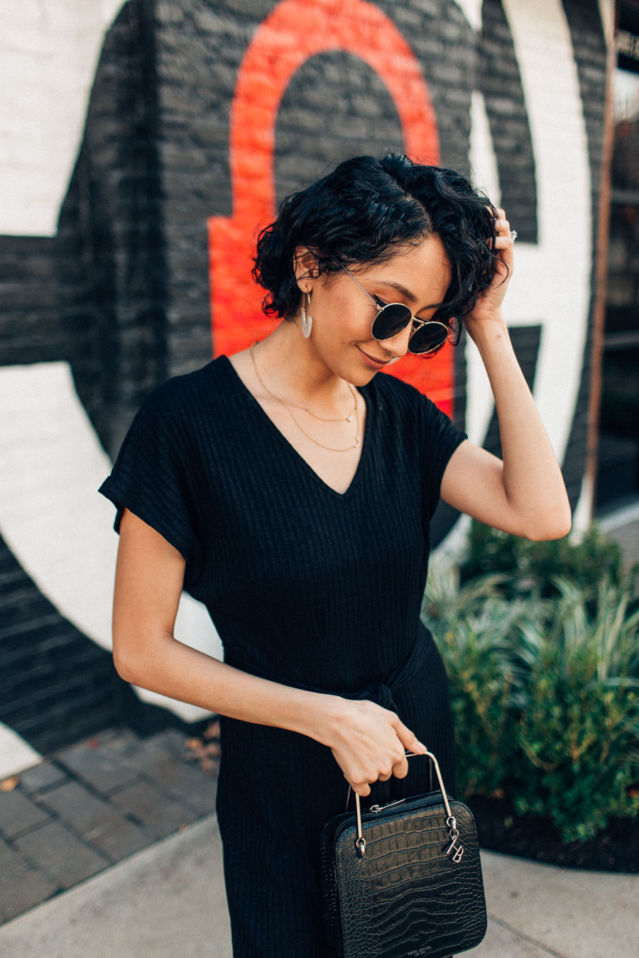Fashion blogger Lilly Beltran wears a black knit jumpsuit for H&M
