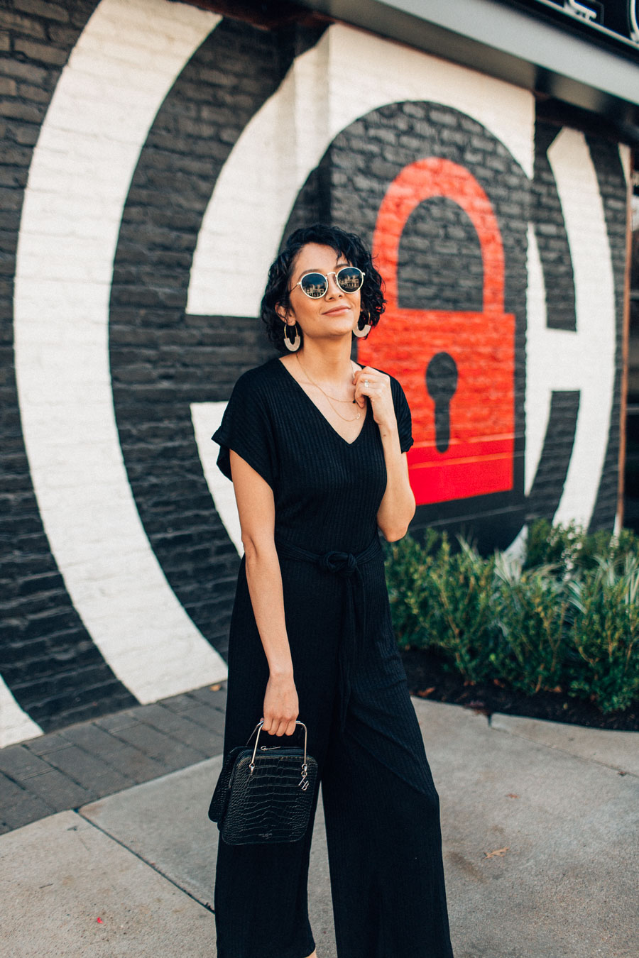 How to wear a basic knit jumpsuit and still look chic.
