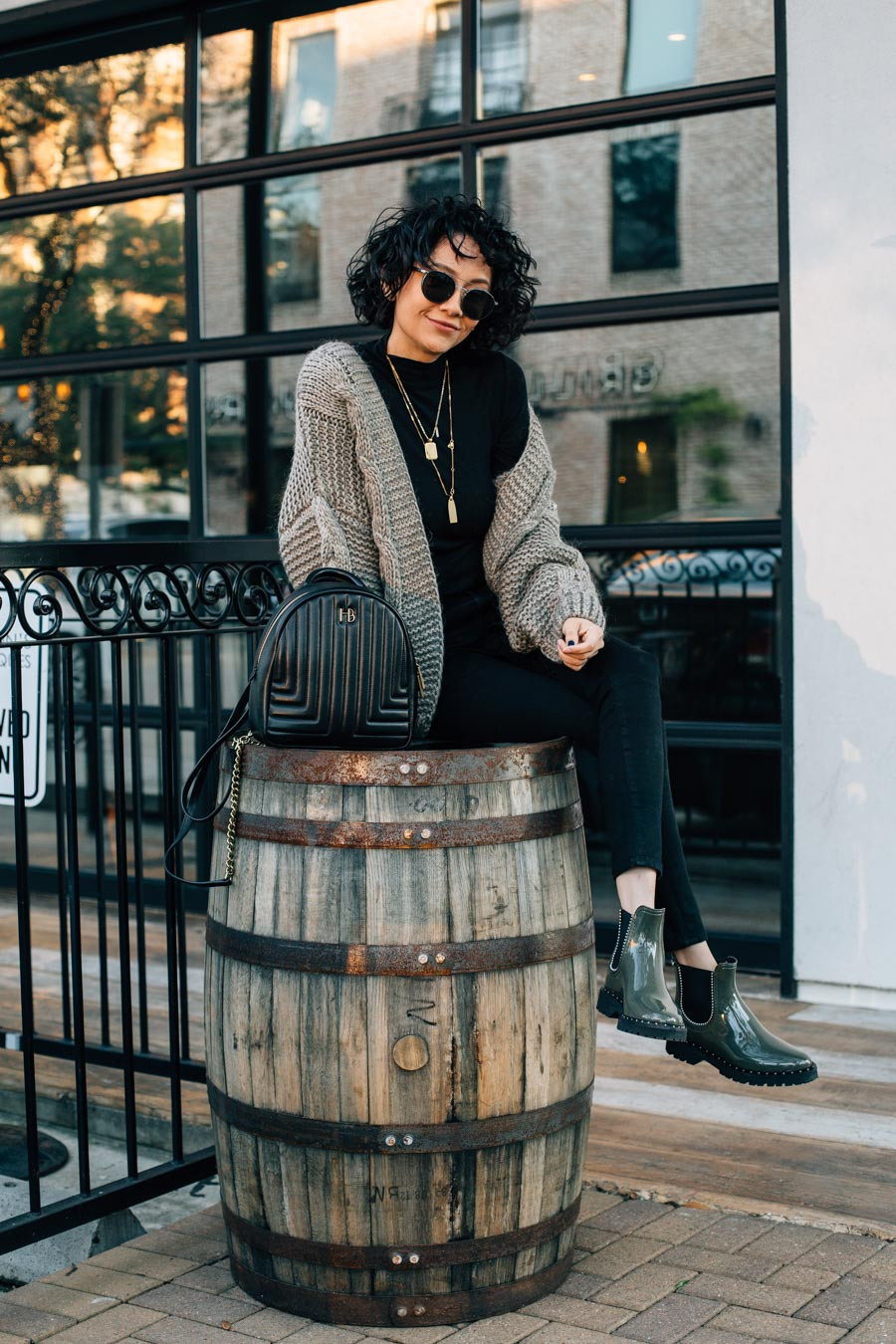 0790da00414e Fashion blogger Lilly Beltran wearing Lemon Jelly Rain Boots with black  skinny jeans and a knit ...