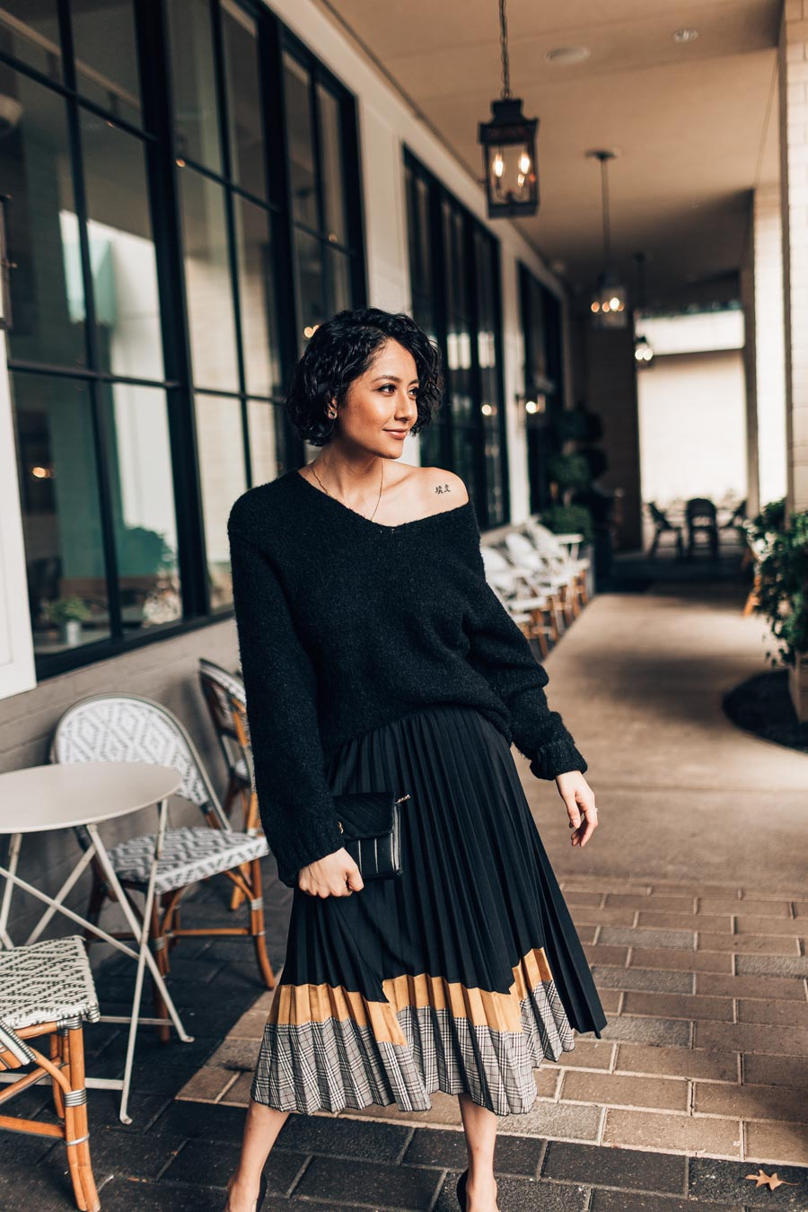 Fashion blogger Lilly Beltran wearing an oversized sweater and Chicwish pleated midi skirt for a street style winter outfit idea.