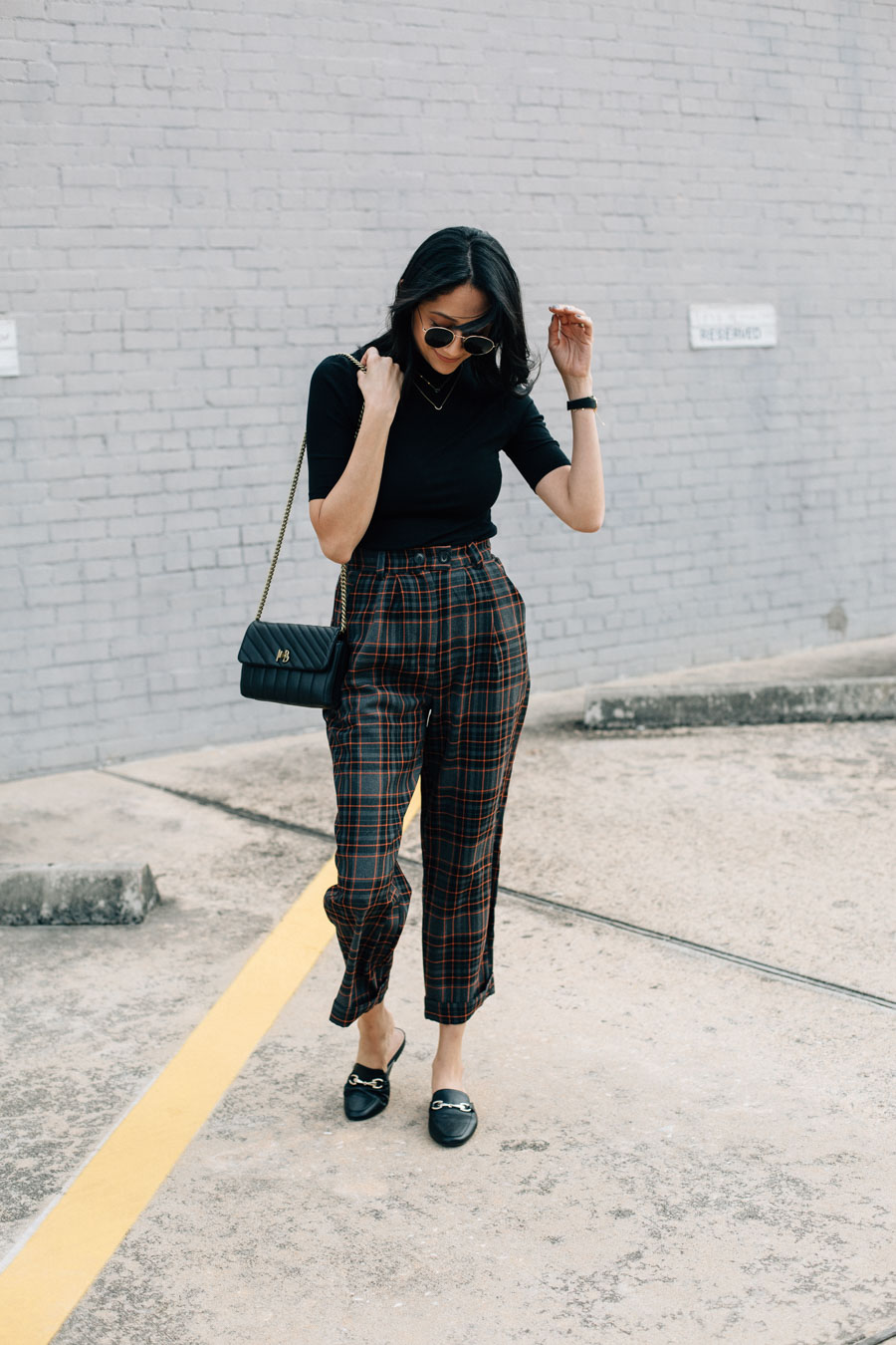 Fashion blogger Lilly Beltran wearing Top shop check peg trousers fro a casual look.