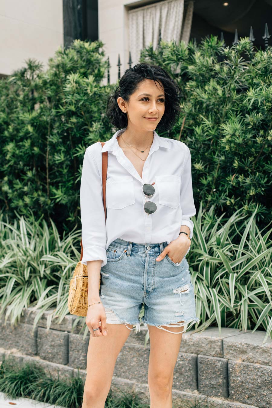 Fashion blogger Lilly Beltran wearing Abercrombie denim shorts & white button up shirt for a classic summer outfit.