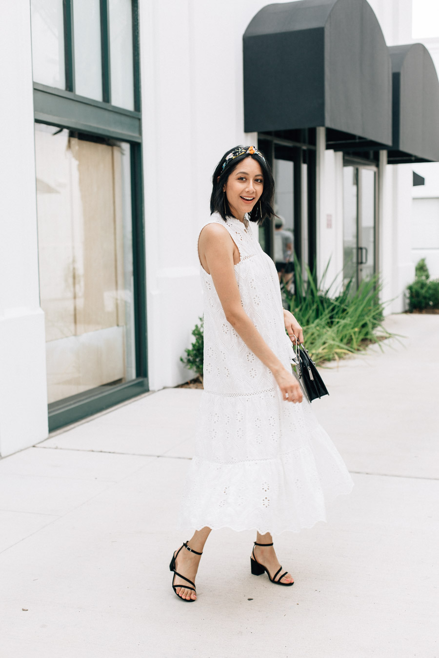 Lilly Beltran wearing a maxi white eyelet dress with black sandals and a J.Crew headband. Plus she shares her thoughts on cleaning up after your children.