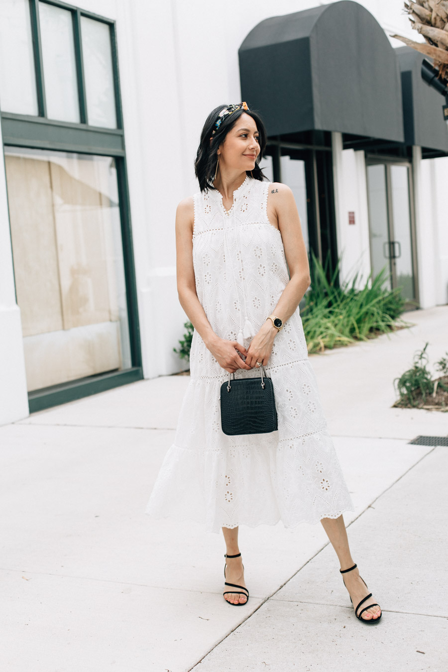 White summer dress & black strappy sandals.