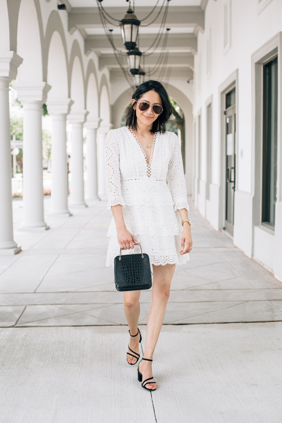Lilly Beltran wearing a white eyelet mini dress + talks about how quitting dairy improved her health.