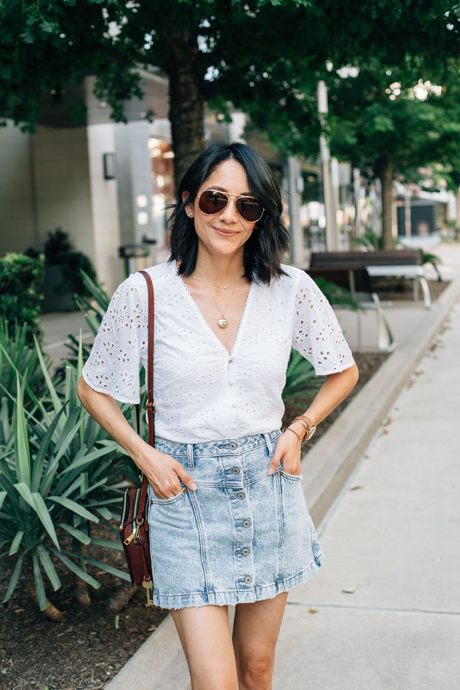 Lilly Beltran in an Abercrombie acid wash denim skirt with a white eyelet top for a fun summer look