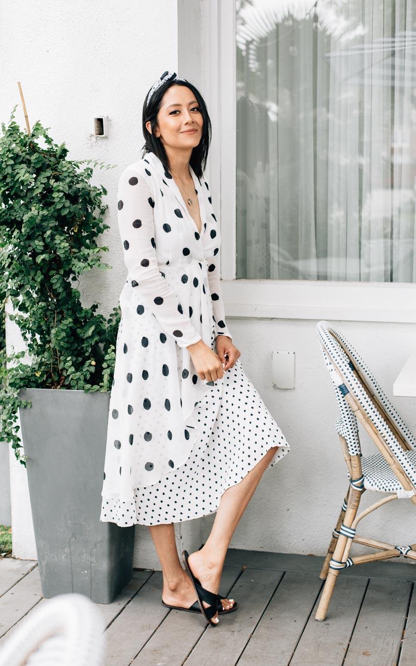 Lilly Beltran wearing a polka dot midi dress by Brazilian brand Farm Rio.