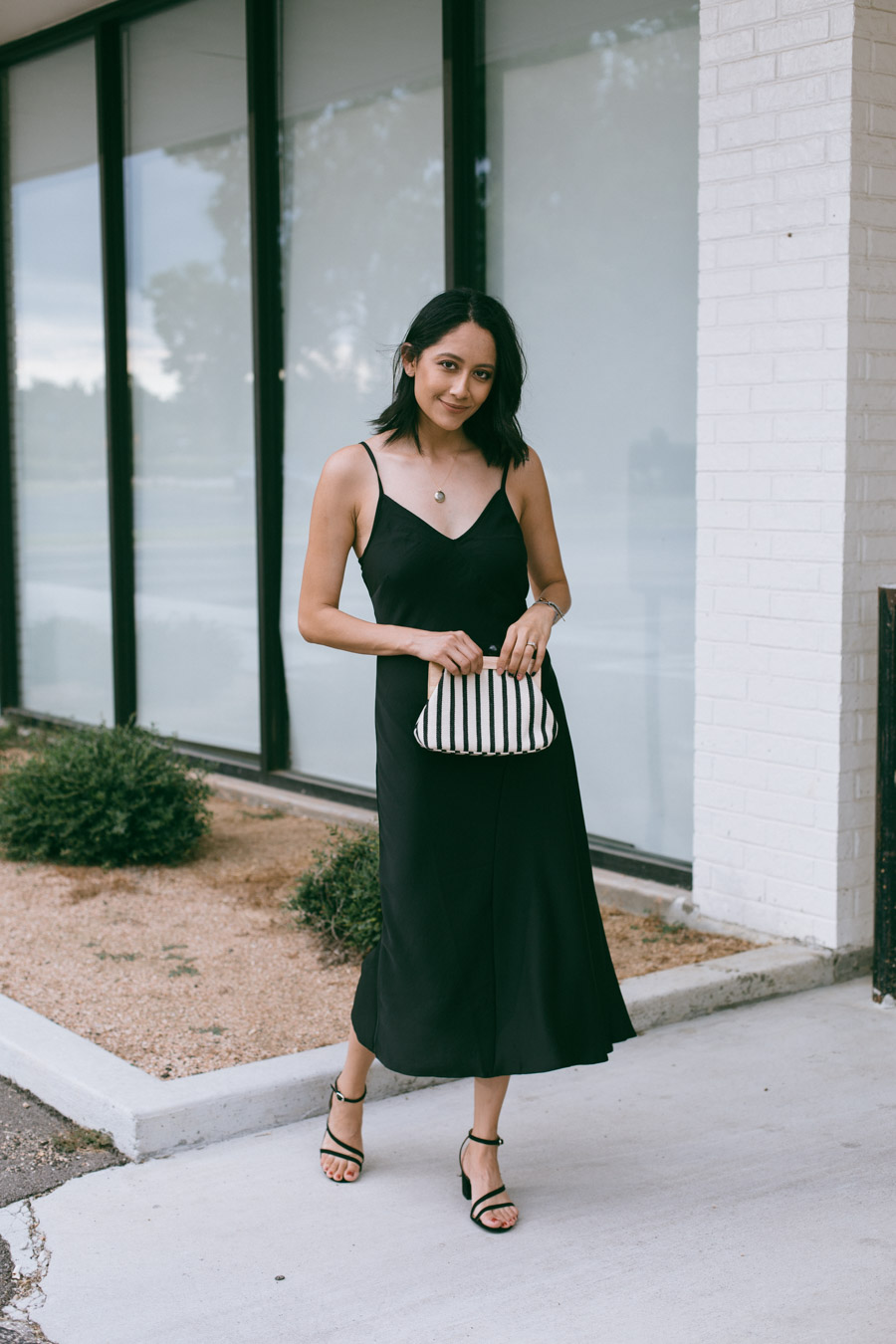 Lilly Beltran in an Asos black dress, Zara clutch and Target sandals for a classic date night look.