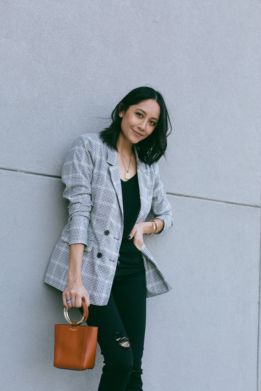 Lilly Beltran wearing Abercrombie black skinny jeans and plaid blazer for a neutral fall look.