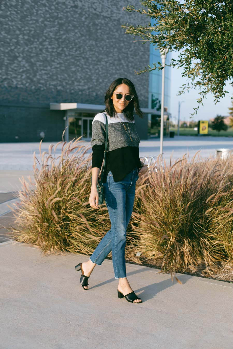Lilly Beltran wearing Old Navy jeans and sweater for an affordable fall look.