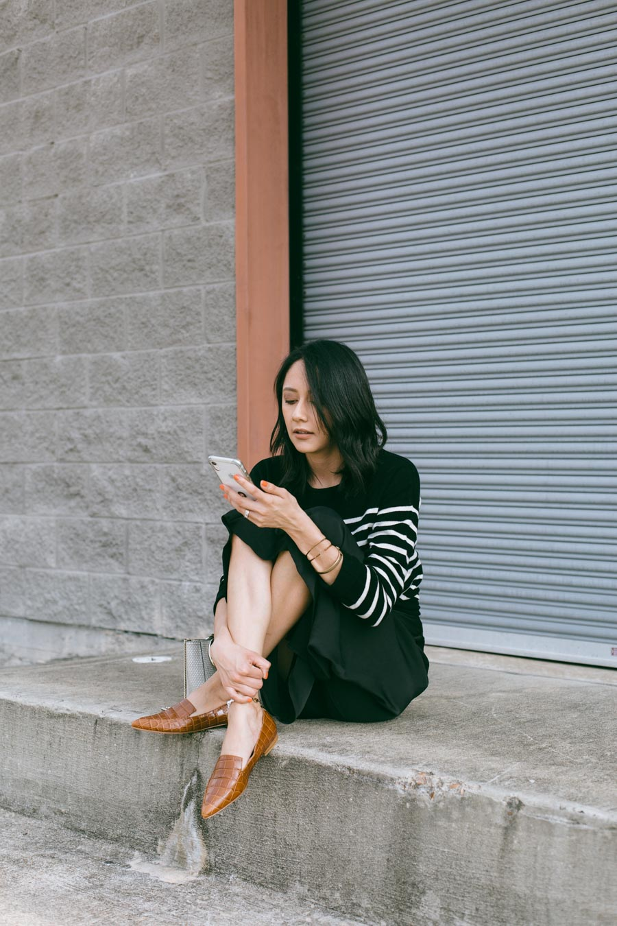 Lilly Beltran of Daily Craving blog wearing Marc Fisher cognac loafers.