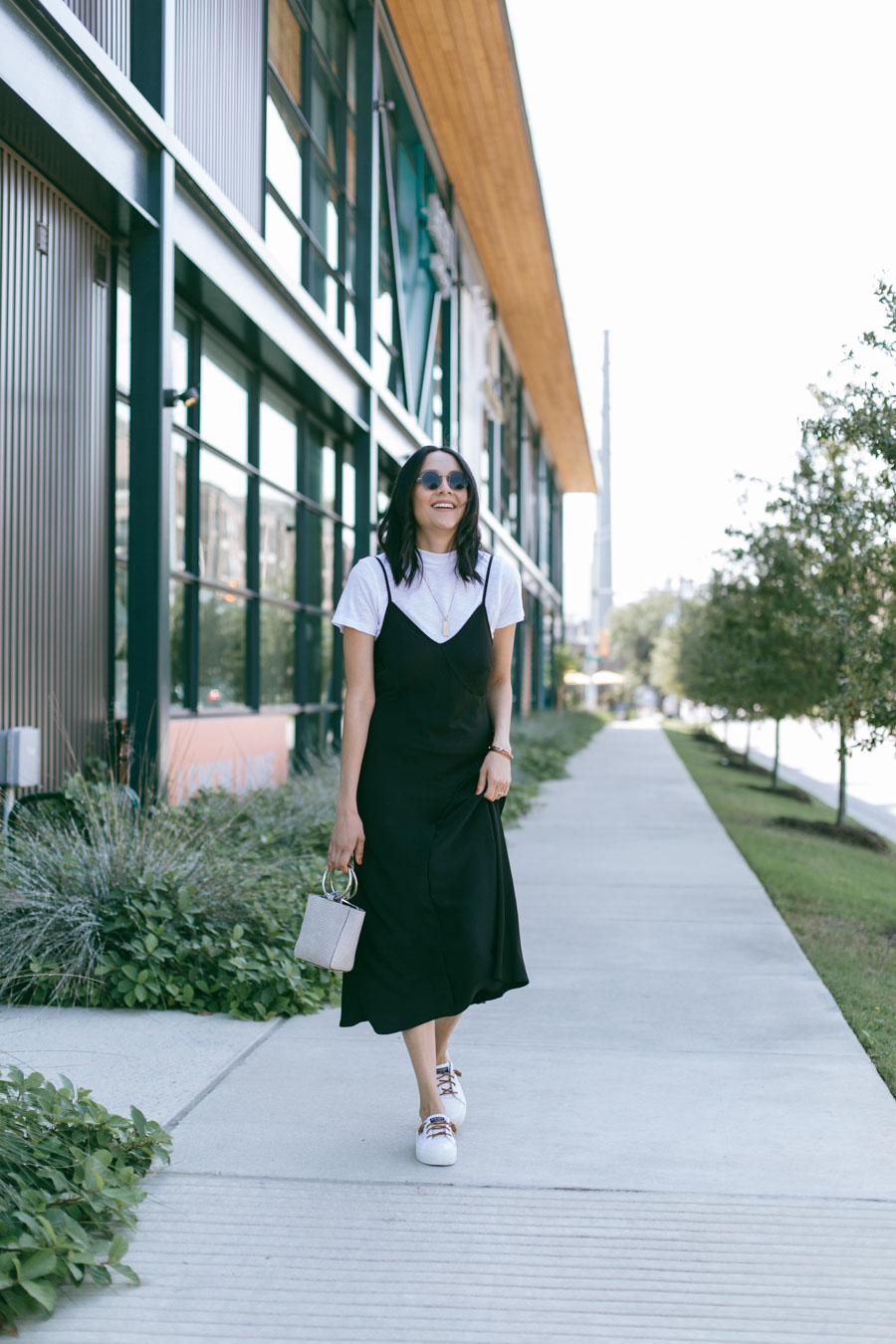 Lilly Beltran restyles a black slip dress and shares tips for being fashionable on a budget