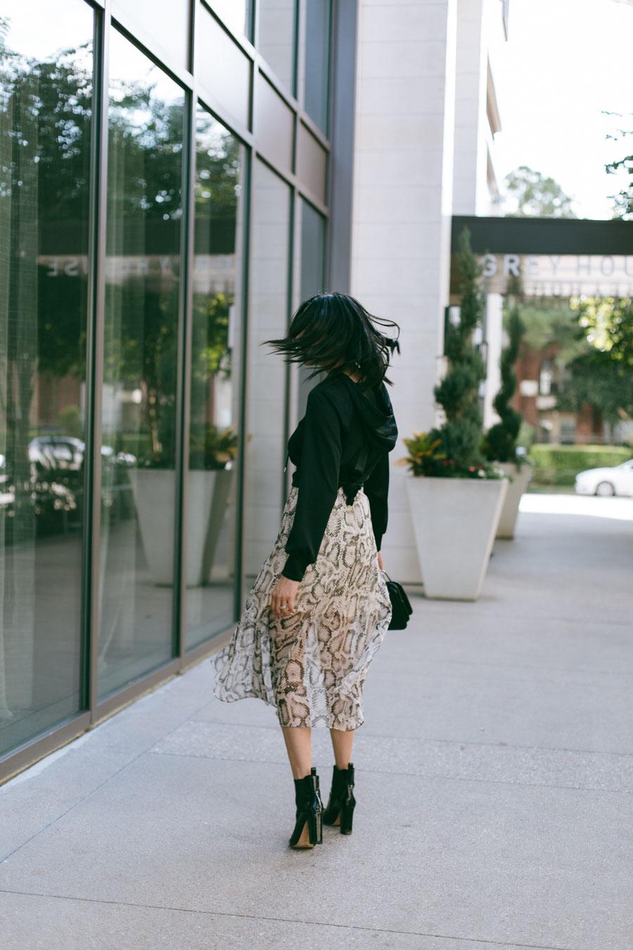Lilly Beltran wearing a chiffon snake print midi skirt