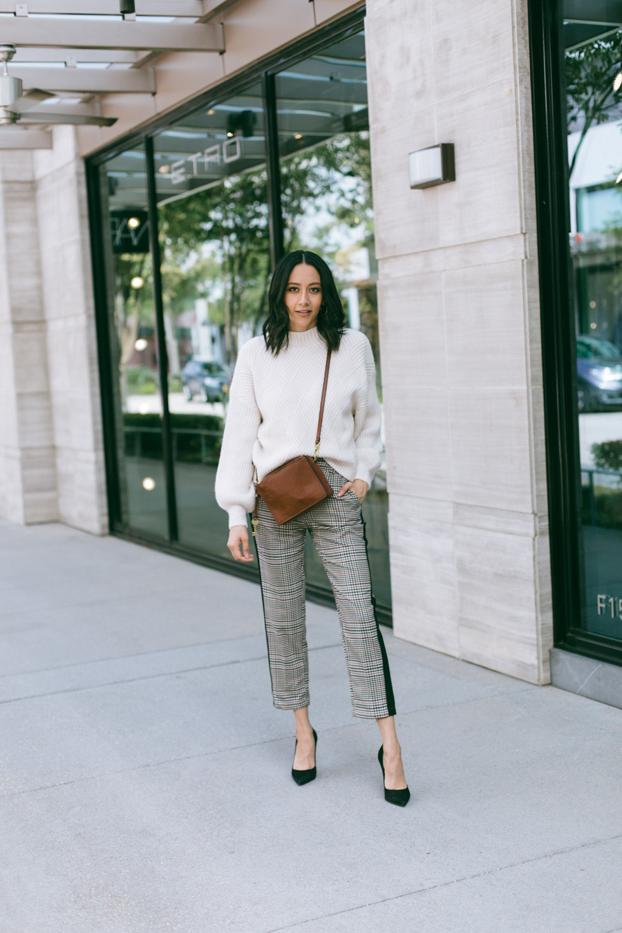 Tips on how to wear plaid this fall. Lilly Beltran wears plaid crop pants with a  chunky sweater.