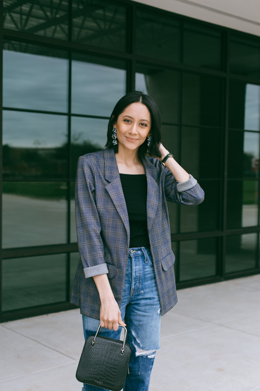 Lilly Beltran in mom jeans and blue plaid blazer for a casual look